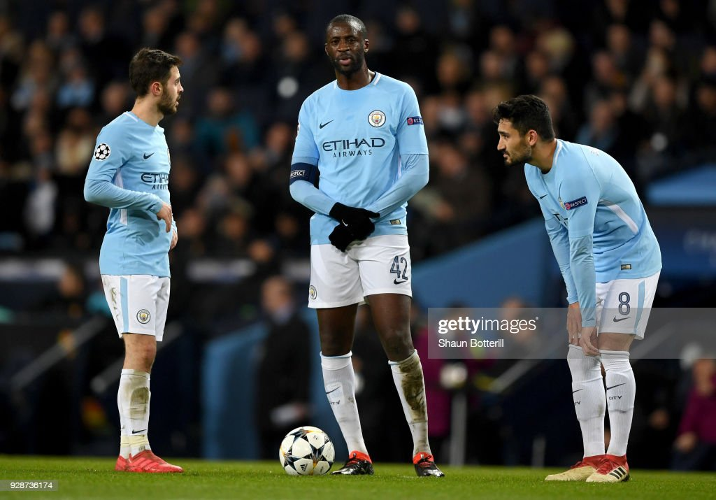 Bernardo Silva (L), Yaya Toure (C) and Ilkay Gundogan (R) of Manchester City look dejected after conceding during the UEFA Champions League Round of 16 Second Leg match between Manchester City and FC Basel at Etihad Stadium on March 7, 2018 in Manchester, United Kingdom.
