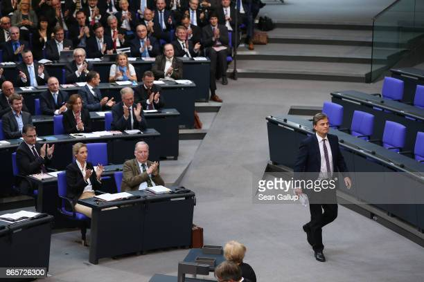 Bernd Baumann of the rightwing Alternative for Germany prepares to speak at the opening session of the new Bundestag as AfD parliamentarians look on...