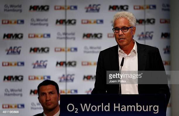 Bernd Boente manager of Wladimir Klitschko talks to the media during a press conference ahead of the upcoming heavyweight boxing title fight between...