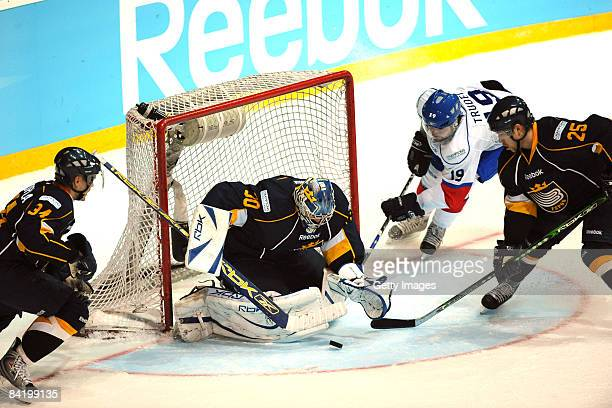 Bernd Bruckler of Espoo Blues and Jean-Guy Trudel of ZSC are seen in action during the IIHF Champions Hockey League semi-final match between Espoo...