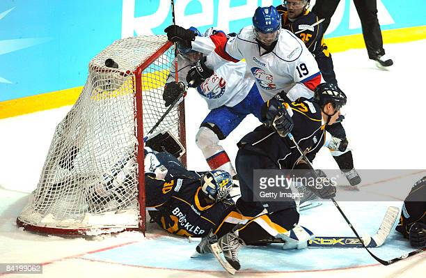 Bernd Bruckler of Espoo Blues and Jean-Guy Trudel of ZSC fight during the IIHF Champions Hockey League semi-final match between Espoo Blues and ZSC...