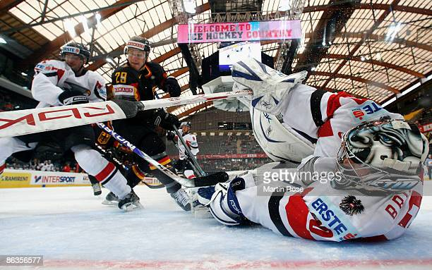 Bernd Brueckler, goalkeeper of Austria saves the puck during the IIHF World Ice Hockey Championship relegation round match between Germany and...