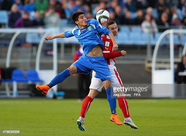Bernd Gschweidl of Austria and Odiljon Hamrobekov of Uzbekistan battle for the ball during the FIFA U20 World Cup round of 16 match between Austria...