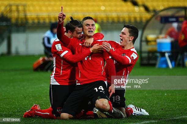 Bernd Gschweidl of Austria celebrates his team's first goal with team mates Daniel Rosenbichler and Martin Rasner during the FIFA U-20 World Cup New...