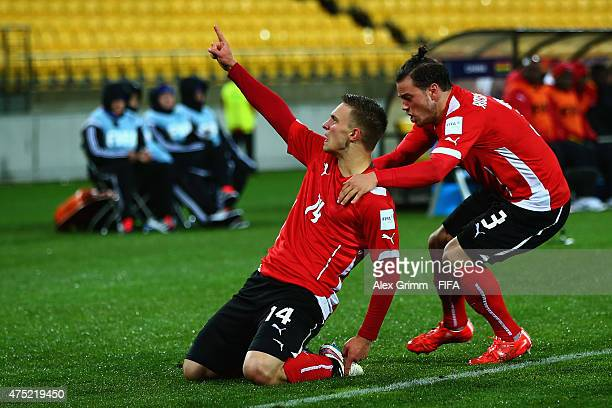 Bernd Gschweidl of Austria celebrates his team's first goal with team mate Daniel Rosenbichler during the FIFA U-20 World Cup New Zealand 2015 Group...