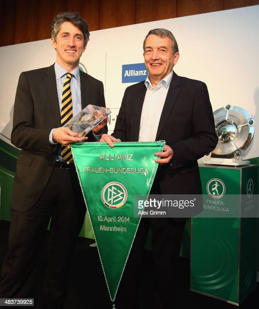 Bernd Heinemann board member of Allianz Germany and head of market management and DFB President Wolfgang Niersbach pose during a press conference on...