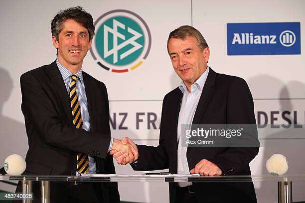 Bernd Heinemann board member of Allianz Germany and head of market management and DFB President Wolfgang Niersbach shake hands after signing a...