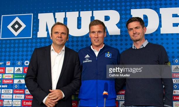 Bernd Hoffmann , chairman and Ralf Becker , sports director of Hamburger SV unveil new signing head coach Hannes Wolf during a press conference at...