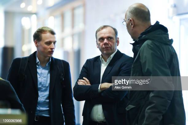 Bernd Hoffmann of Hamburg, chats with Sven Brux, Head of Security, and Kolja Dickmann, Head of Executive Department of the Managing Board & Club...