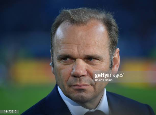 Bernd Hoffmann of Hamburg looks on before the DFB Cup semi final match between Hamburger SV and RB Leipzig at Imtech Arena on April 23, 2019 in...