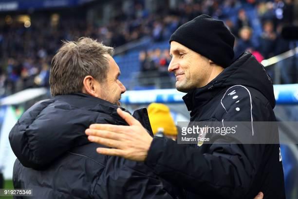 Bernd Hollerbach, coach of Hamburg, shakes hands with Heiko Herrlich, coach of Bayer Leverkusen, before the Bundesliga match between Hamburger SV and...