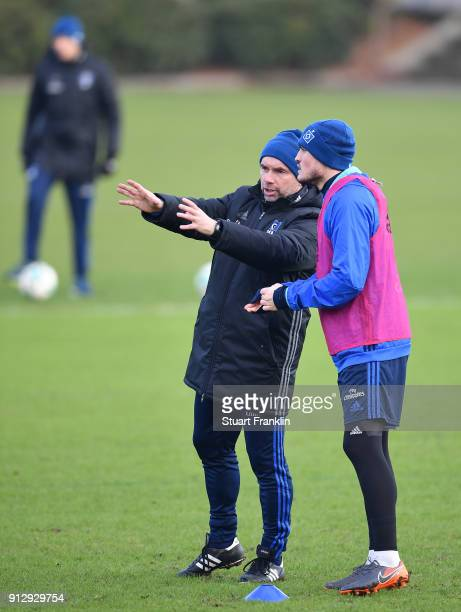Bernd Hollerbach head coach of Hamburg gestures to Kyriakos Papadopoulos during a training session of Hamburger SV at Volksparkstadion on February 1...