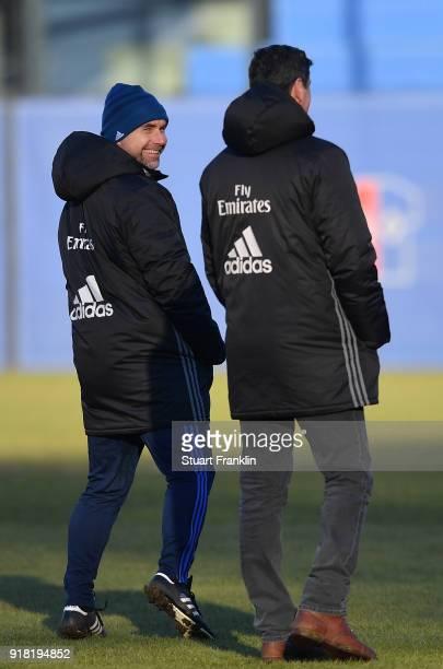 Bernd Hollerbach, head coach of Hamburg smiles at Jens Todt, sports director of Hamburg during a training session of Hamburger SV at Volksparkstadion...