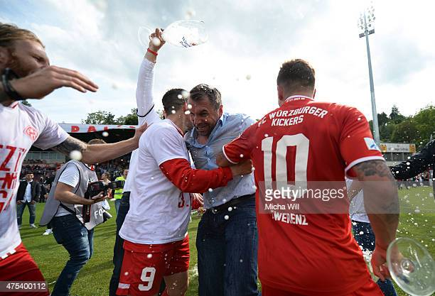 Bernd Hollerbach , head coach of Wuerzburg is doused with beer after during the Regionalliga Playoffs match between Wuerzburger Kickers and 1. FC...