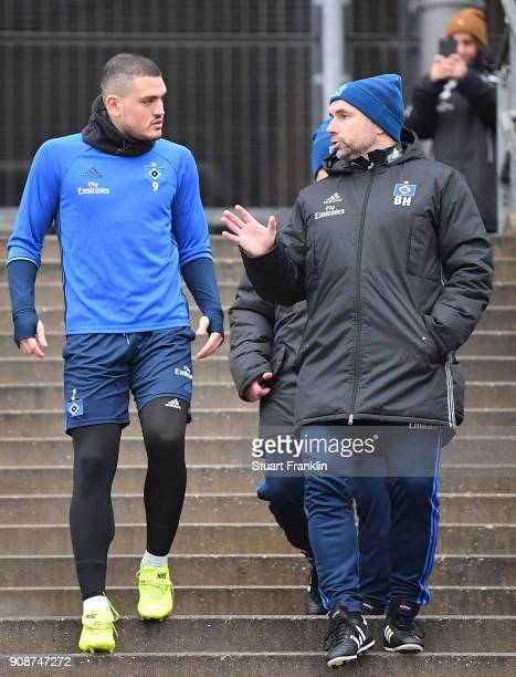 Bernd Hollerbach new head coach of Hamburger SV talks with Kyriakos Papadopoulos during a training session of Hamburger SV at Volksparkstadion on...