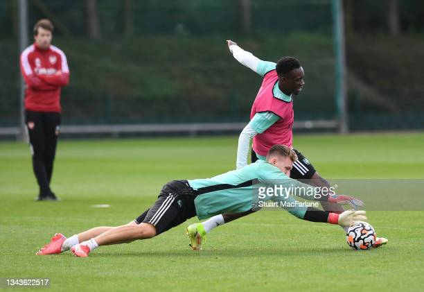 Bernd Leno and Flo Balogun of Arsenal during a training session at London Colney on September 28, 2021 in St Albans, England.