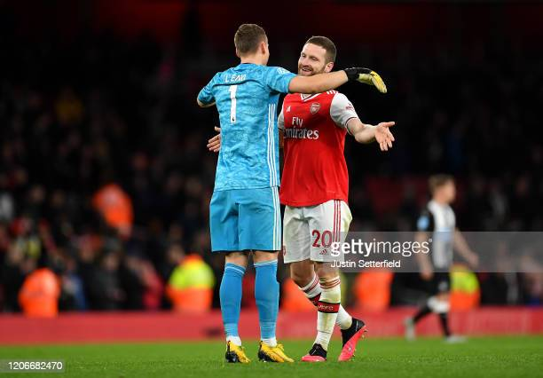 Bernd Leno and Shkodran Mustafi of Arsenal celebrate victory during the Premier League match between Arsenal FC and Newcastle United at Emirates...