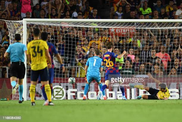 Bernd Leno and Sokratis Papastathopoulos of Arsenal faisl to stop the ball as Ainsley MaitlandNiles of Arsenal scores an own goal for Barcelona's...