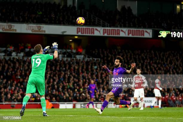 Bernd Leno of Arsenal and Mohamed Salah of Liverpool during the Premier League match between Arsenal FC and Liverpool FC at Emirates Stadium on...
