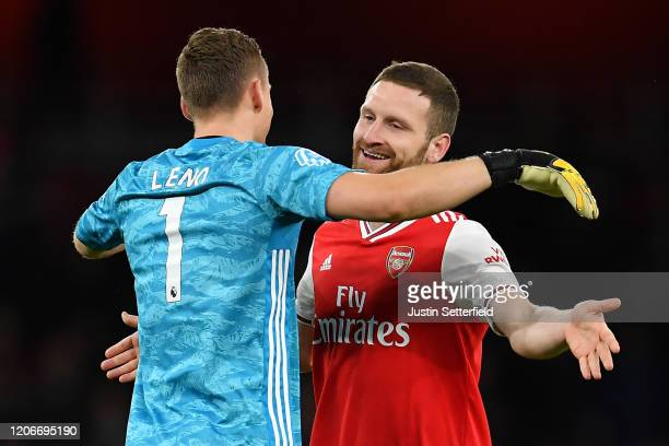 Bernd Leno of Arsenal and Shkodran Mustafi of Arsenal embrace after the Premier League match between Arsenal FC and Newcastle United at Emirates...