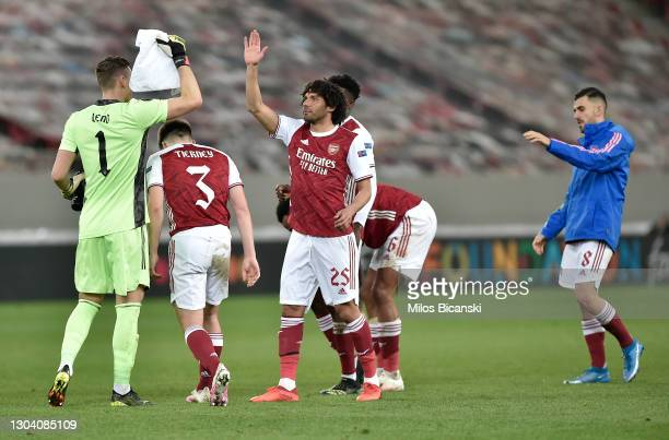 Bernd Leno of Arsenal celebrates with Mohamed Elneny of Arsenal after the UEFA Europa League Round of 32 match between Arsenal FC and SL Benfica at...