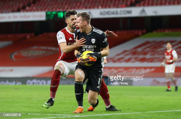 Bernd Leno of Arsenal celebrates with teammate Pablo Mari of Arsenal after making a penalty save during the Premier League match between Arsenal and...