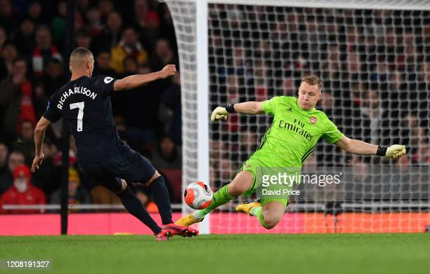 Bernd Leno of Arsenal challenges Richarlison of Everton during the Premier League match between Arsenal FC and Everton FC at Emirates Stadium on...