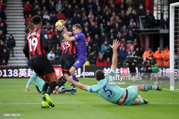 Bernd Leno of Arsenal clashes with Callum Wilson of AFC Bournemouth during the Premier League match between AFC Bournemouth and Arsenal FC at...