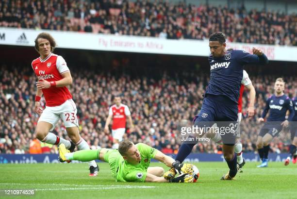 Bernd Leno of Arsenal makes a save at the feet of Sebastien Haller of West Ham United during the Premier League match between Arsenal FC and West Ham...