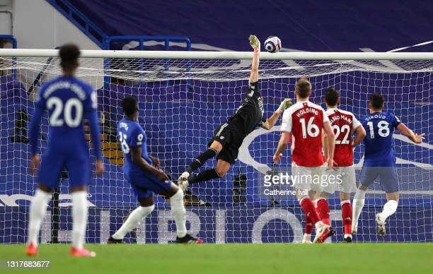 Bernd Leno of Arsenal makes a save from Kurt Zouma of Chelsea during the Premier League match between Chelsea and Arsenal at Stamford Bridge on May...