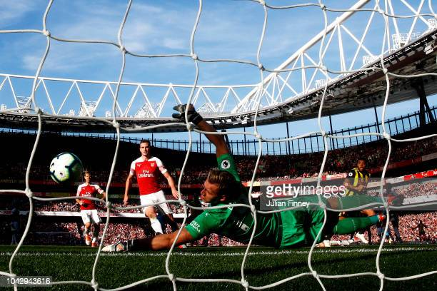Bernd Leno of Arsenal makes a save from Troy Deeney of Watford during the Premier League match between Arsenal FC and Watford FC at Emirates Stadium...