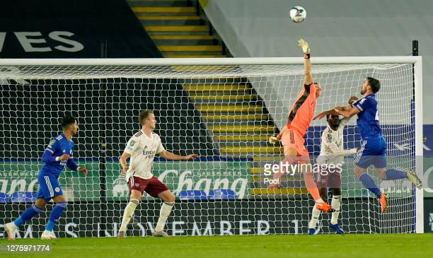 Bernd Leno of Arsenal reaches for the ball as he is put under pressure by Christian Fuchs of Leicester City during the Carabao Cup third round match...