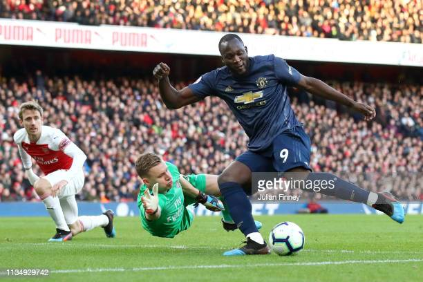 Bernd Leno of Arsenal reaches for the ball as Romelu Lukaku of Manchester United shoots during the Premier League match between Arsenal FC and...