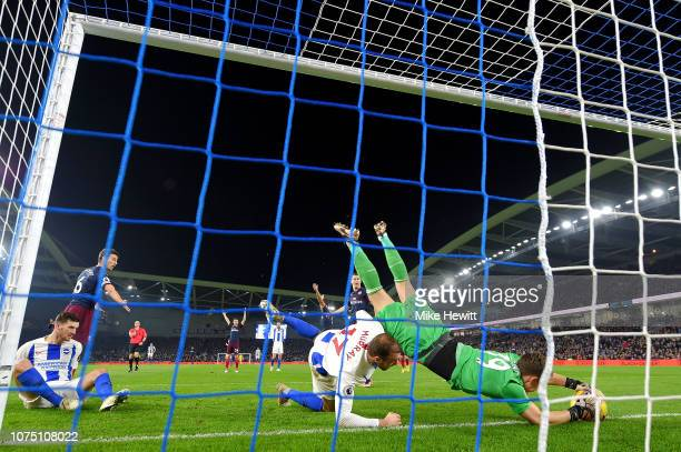 Bernd Leno of Arsenal saves the ball on the goal line during the Premier League match between Brighton Hove Albion and Arsenal FC at American Express...