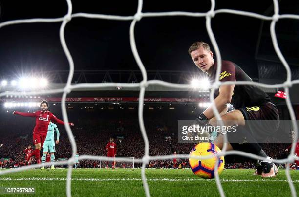 Bernd Leno of Arsenal shows hos dejection as Mohamed Salah of Liverpool celebrates after his team mate Roberto Firmino has scored the first goal...