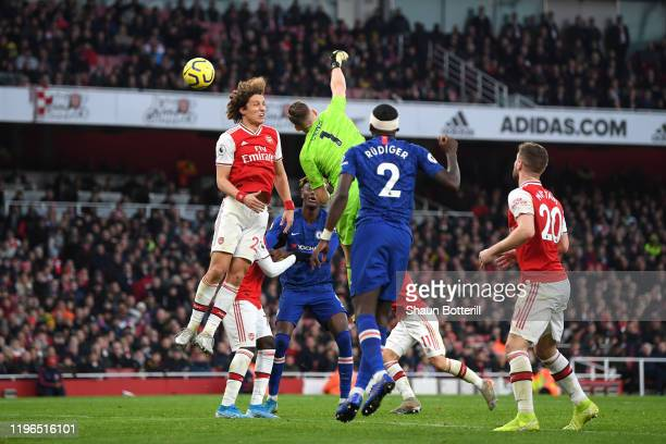 Bernd Leno of Arsenal unsuccessfully attempts to clear the ball leading to Chelsea's first goal during the Premier League match between Arsenal FC...