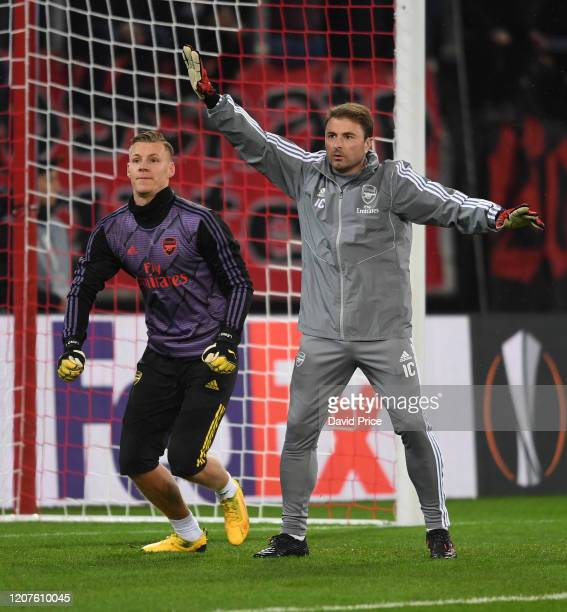 Bernd Leno of Arsenal warms up with Goalkeeping Coach Inaki Cana before the UEFA Europa League round of 32 first leg match between Olympiacos FC and...