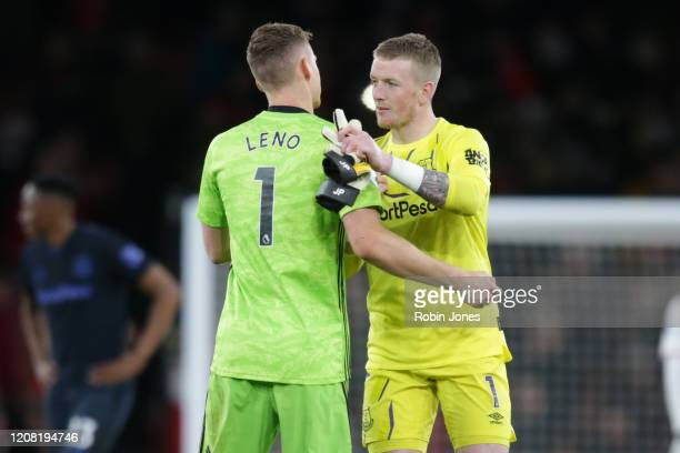 Bernd Leno of Arsenal with Jordan Pickford of Everton after Arsenal's 32 win during the Premier League match between Arsenal FC and Everton FC at...