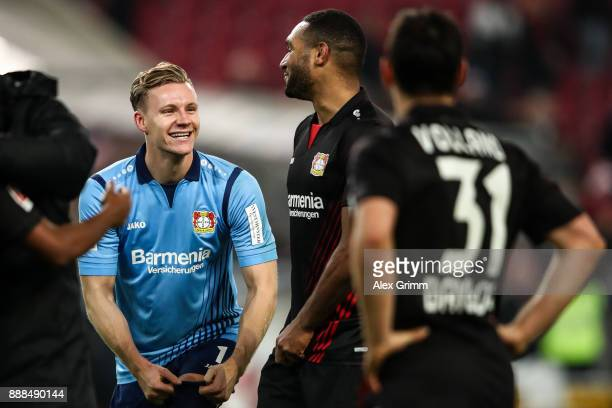 Bernd Leno of Bayer Leverkusen and Jonathan Tah celebrate after winning the Bundesliga match between VfB Stuttgart and Bayer 04 Leverkusen at...