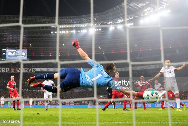 Bernd Leno of Bayer Leverkusen fails to stop Franck Ribery of Bayern Muenchen as he scores their second goal during the Bundesliga match between...