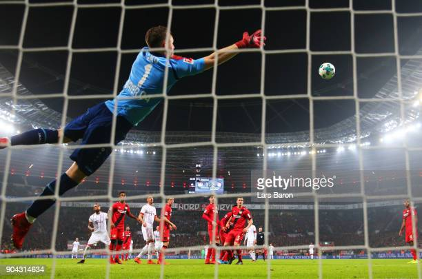 Bernd Leno of Bayer Leverkusen fails to stop James Rodriguez of Bayern Muenchen as he scores their third goal from a free kick during the Bundesliga...