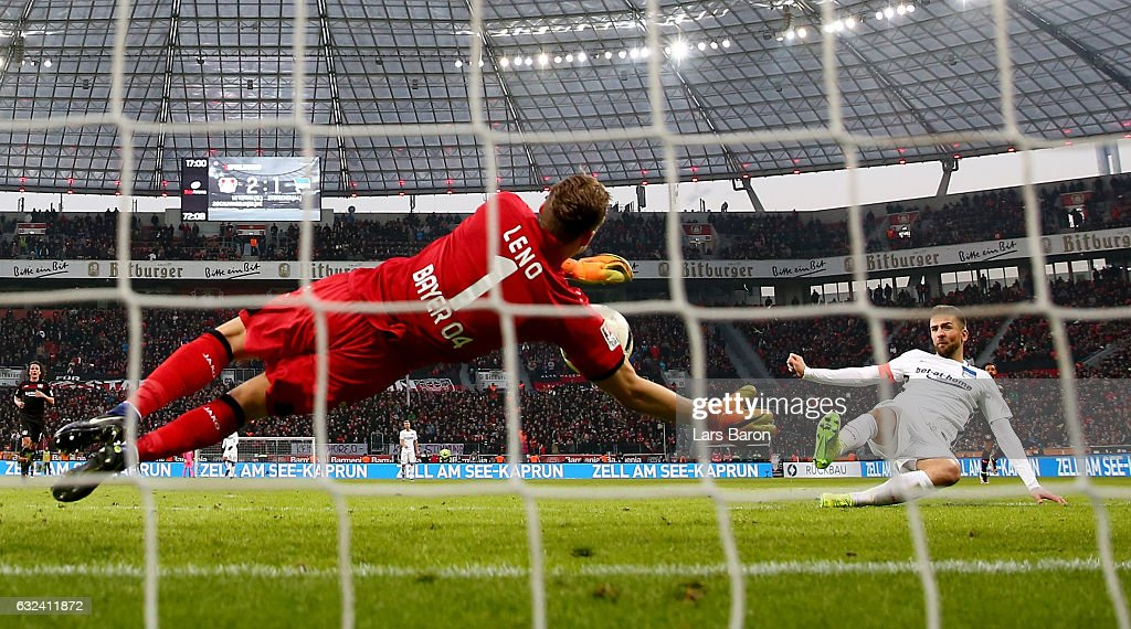 Bernd Leno of Bayer Leverkusen saves a shot of Vedad Ibisevic of Berlin during the Bundesliga match between Bayer 04 Leverkusen and Hertha BSC at BayArena on January 22, 2017 in Leverkusen, Germany.