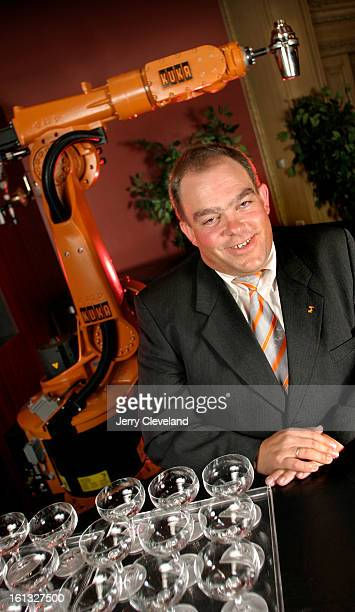 DENVER COLO JULY 20 2004 Bernd Liepert <cq> president and CEO of KUKA Roboter GmbH <cq> Augsburg Germany stands with a KUKA robot at the 2004 Japan...