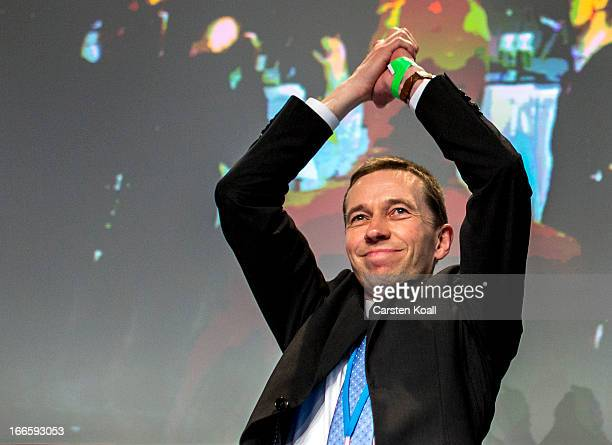 Bernd Lucke founder of the Alternative fuer Deutschland political party waves after being elected as one of three new elected party leaders at the...