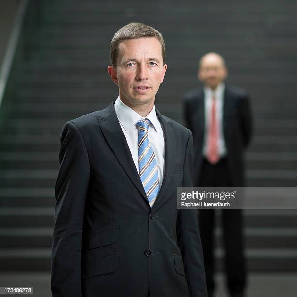 Bernd Lucke founder of the 'Alternative fuer Deutschland' political party and Stephan Boyens poses for a photograph on July 15 2013 in Berlin Germany...