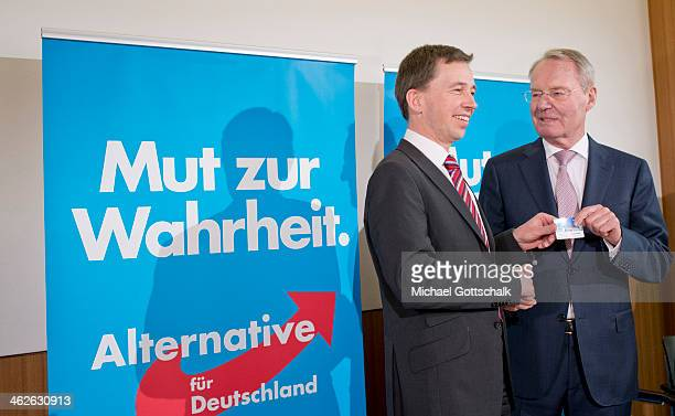 Bernd Lucke Head of German Alternative for Germany Party AFD hands over a member card to new pary member and Former President of the Federation of...