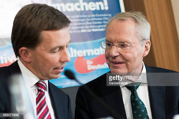 Bernd Lucke head of the Alternative fuer Deutschland political party attends a press conference with colleague HansOlaf Henkel AfD Brandenburg lead...