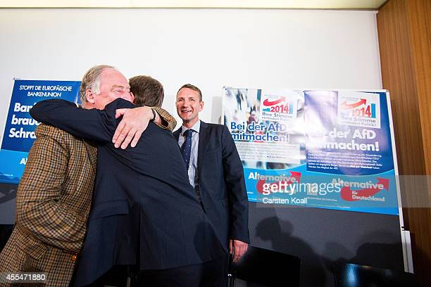 Bernd Lucke head of the Alternative fuer Deutschland political party hugs colleague AfD Brandenburg lead candidate Alexander Gauland and AfD...
