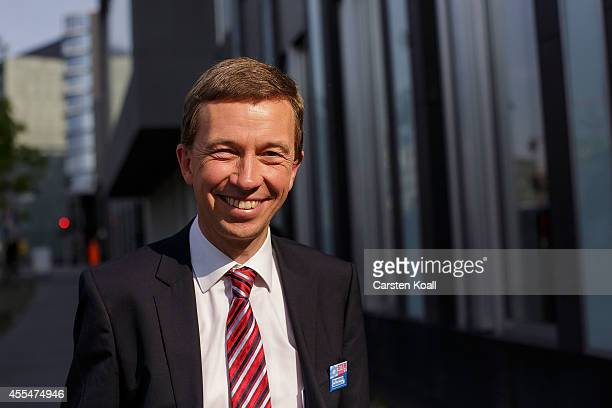 Bernd Lucke head of the Alternative fuer Deutschland political party smiles as he left a pressconference the day after the AfD finished with strong...