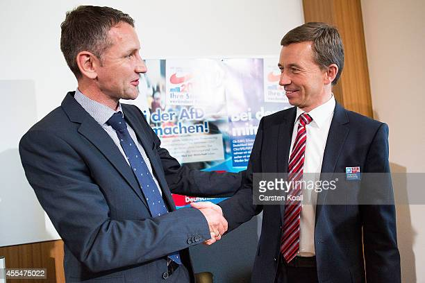Bernd Lucke head of the Alternative fuer Deutschland political party shakes the hand after a press conference with colleague AfD Thuringia lead...